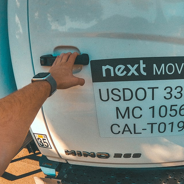 Next Moving professional furniture movers near me is opening moving trucks door with USDOT, MC and CAL-T number on it ready to provide furniture delivery service and cargo delivery.