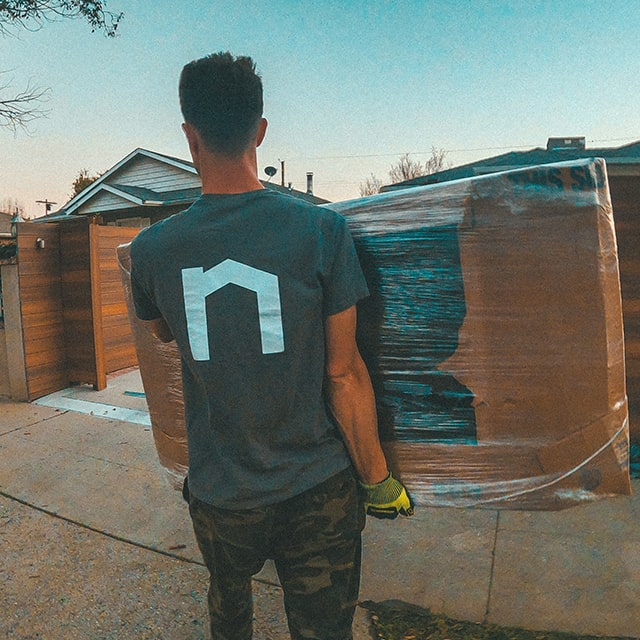 Next Moving professional local mover shows his knowledge of best moving tips and tricks, moving hacks, carrying properly wrapped TV