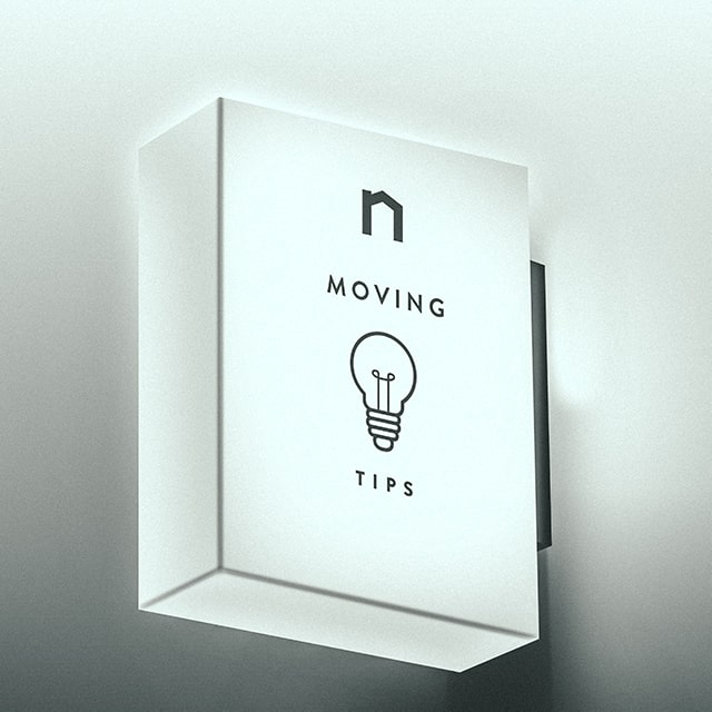 Square lamp with Next Moving logo and best moving tips and tricks, moving hacks text on it shines white light.