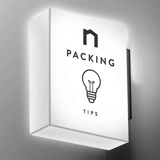 Square lamp with Next Moving logo and packing hacks, packing tips, packing tips for moving, moving packing tips, packing hacks for moving, moving packing hacks, packing hacks moving text on it shines white light.